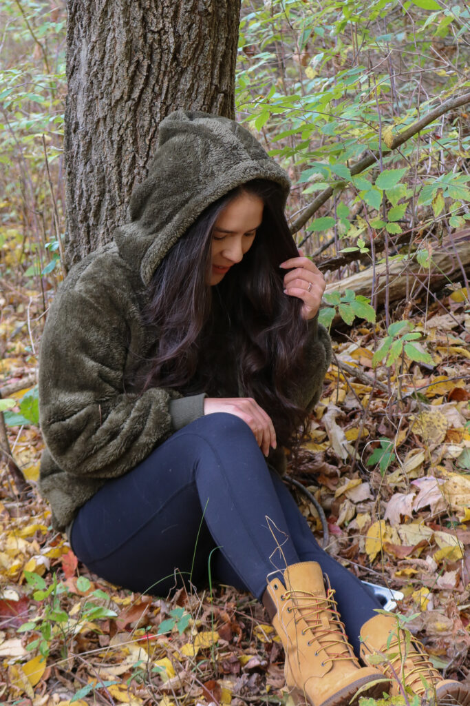 Olive green hooded pullover and timberland boots